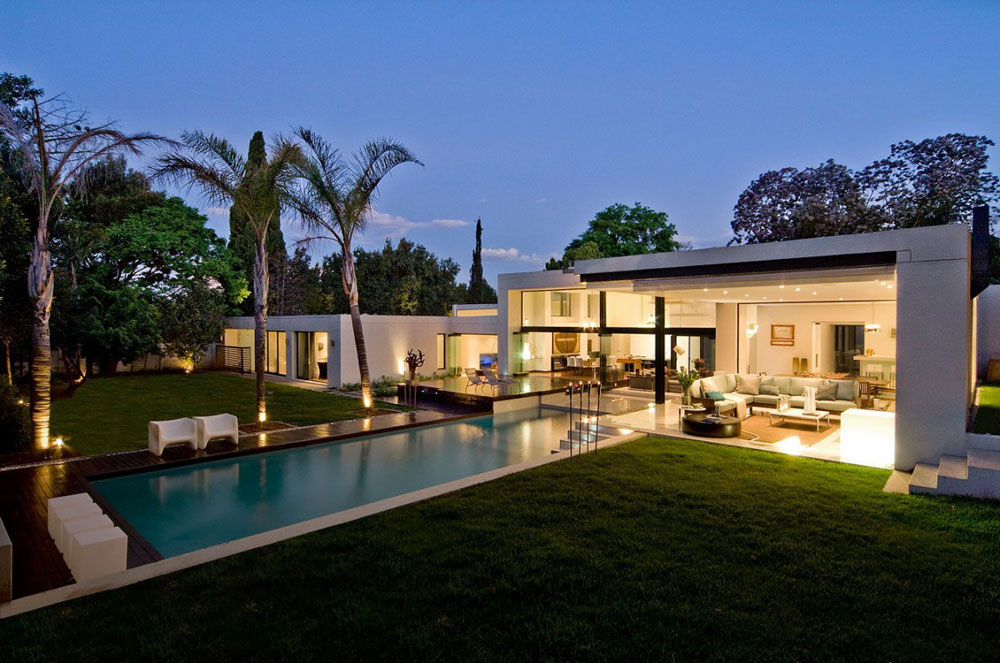 House and Pool at Night - Moss Oaklands Residence