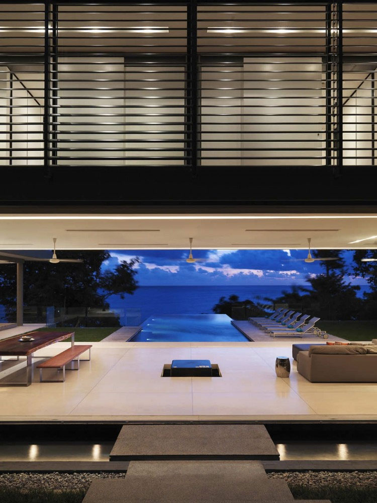Villa Amanzi, pool blends into the sea at night
