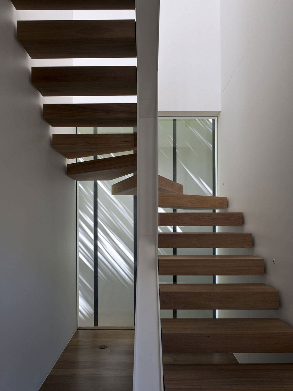 Stairs, Skirt + Rock House by MCK Architects
