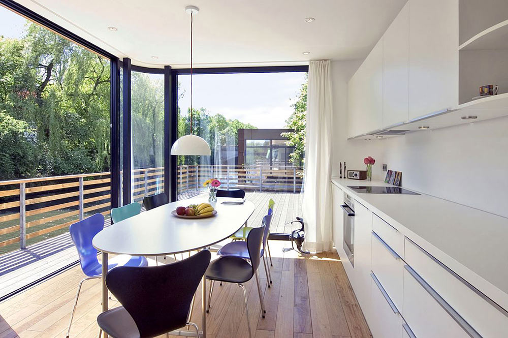 Kitchen, Dining, Houseboat, Eilbek Canal by Rost Niderehe Architects