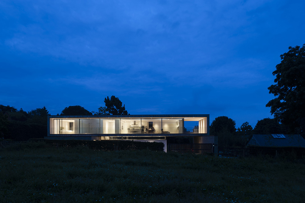 Evening Lights, Hurst House, Buckinghamshire by John Pardey Architects + Strom Architects