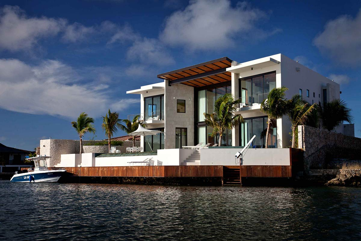 Modern waterfront home bonaire the netherlands antilles for Canal front house plans