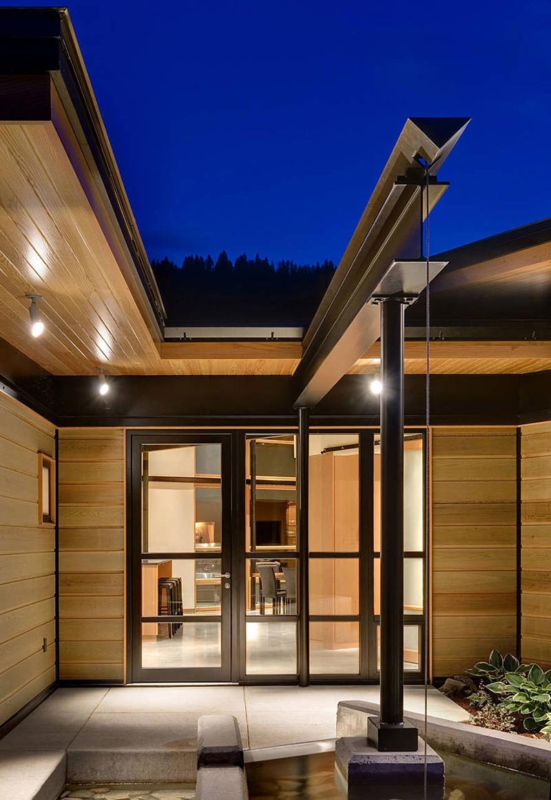Front Door, Water Feature, River Bank House, Montana by Balance Associates Architects
