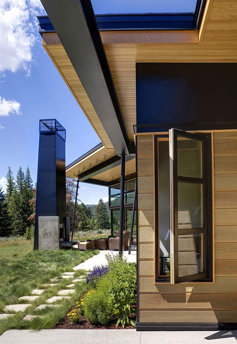 Outdoor Fire, Chimney, River Bank House, Montana by Balance Associates Architects