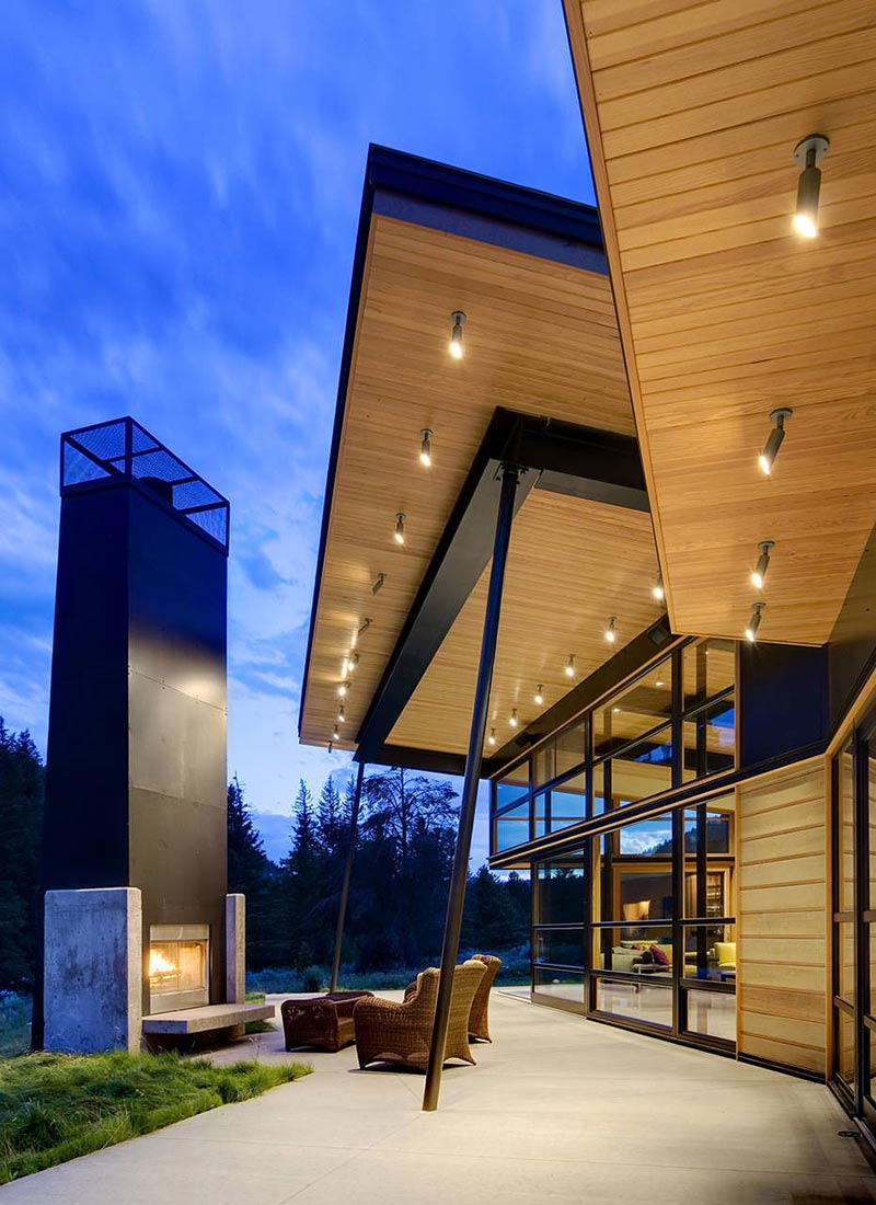 Outdoor Fireplace, Seating, Terrace, River Bank House, Montana by Balance Associates Architects