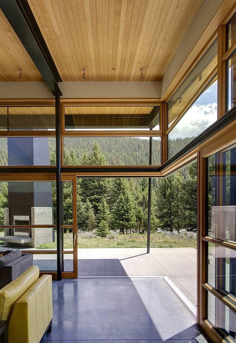 Sliding Glass Walls, River Bank House, Montana by Balance Associates Architects