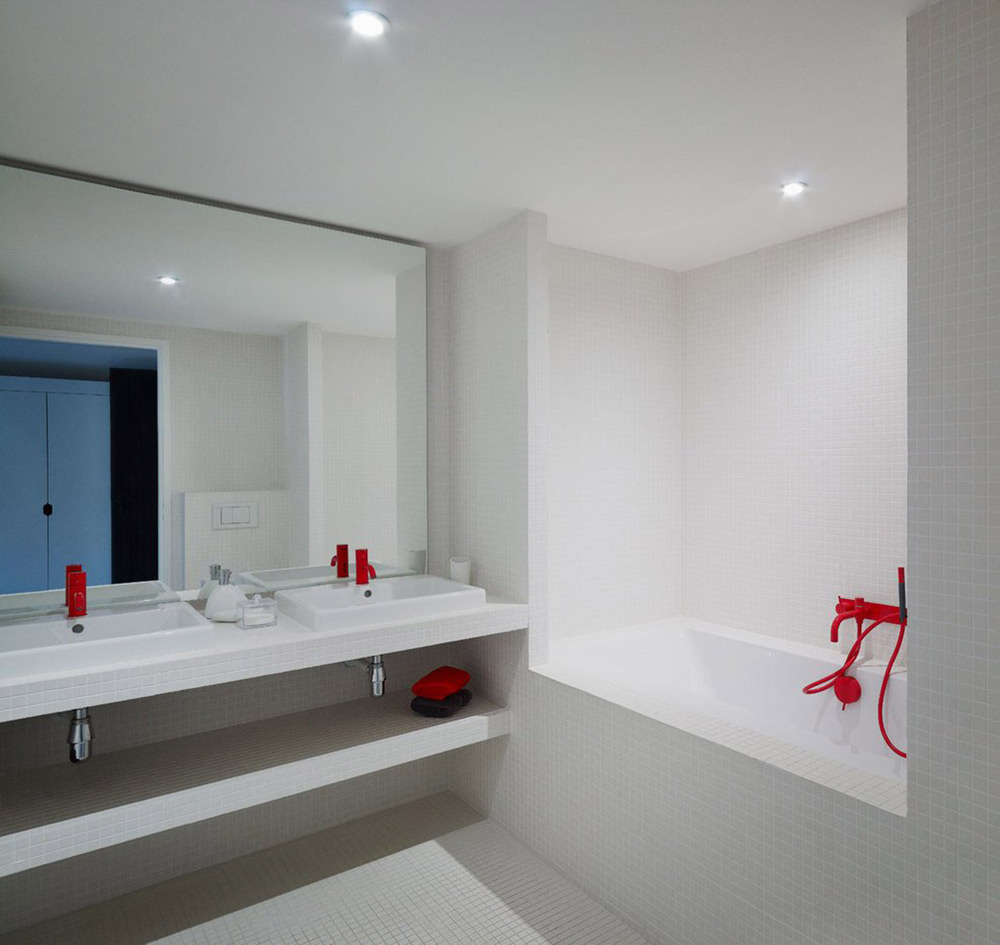 White Bathroom, Red Faucets, Villa Solaire, Morzine, France by JKA + FUGA