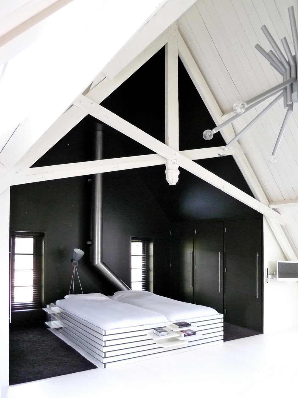 Dark Bedroom, White Wooden Bed, Unique Loft Conversion in The Netherlands