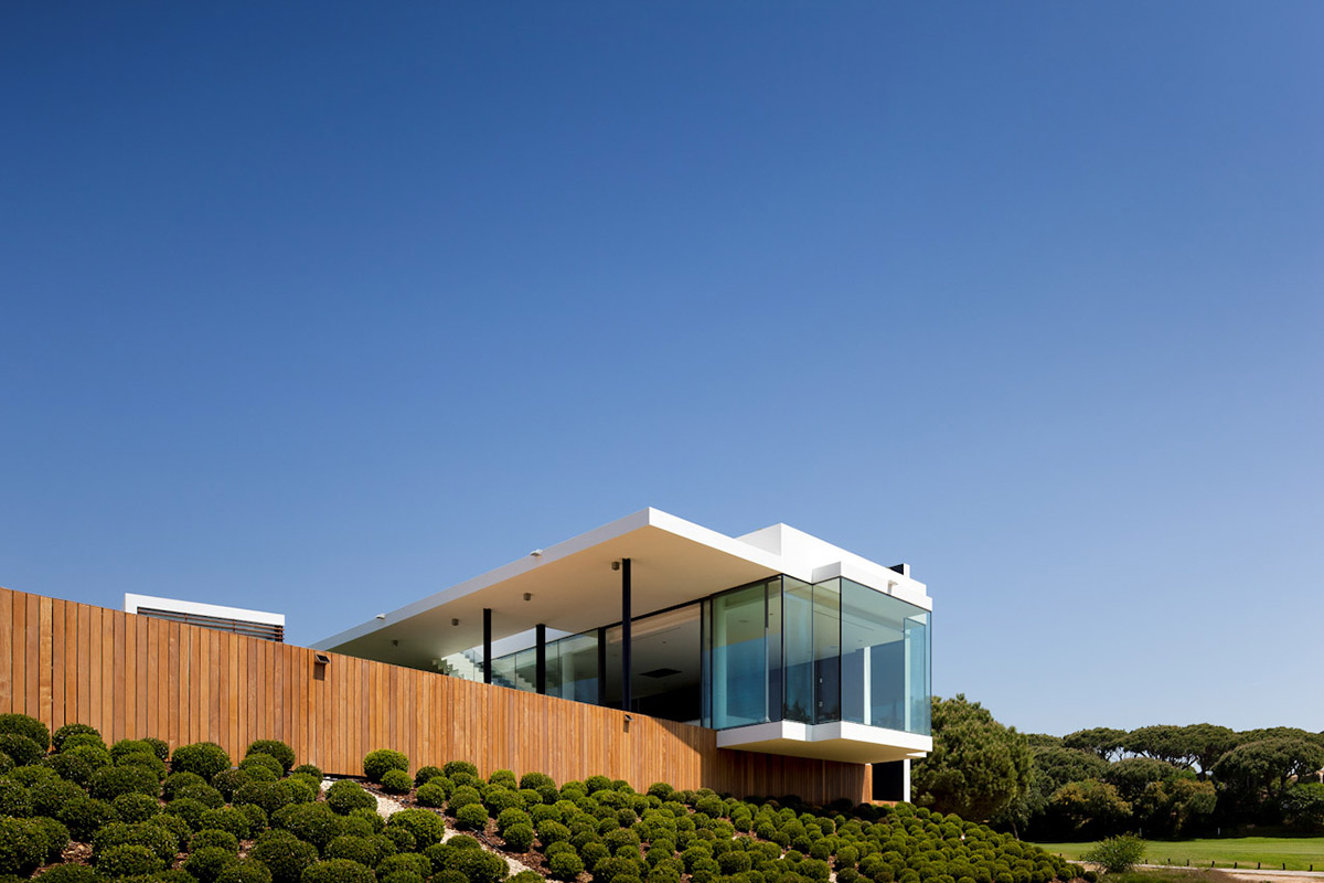 Glass Walls, Garden, Modern Home with a Unique Suspended Pool in Portugal