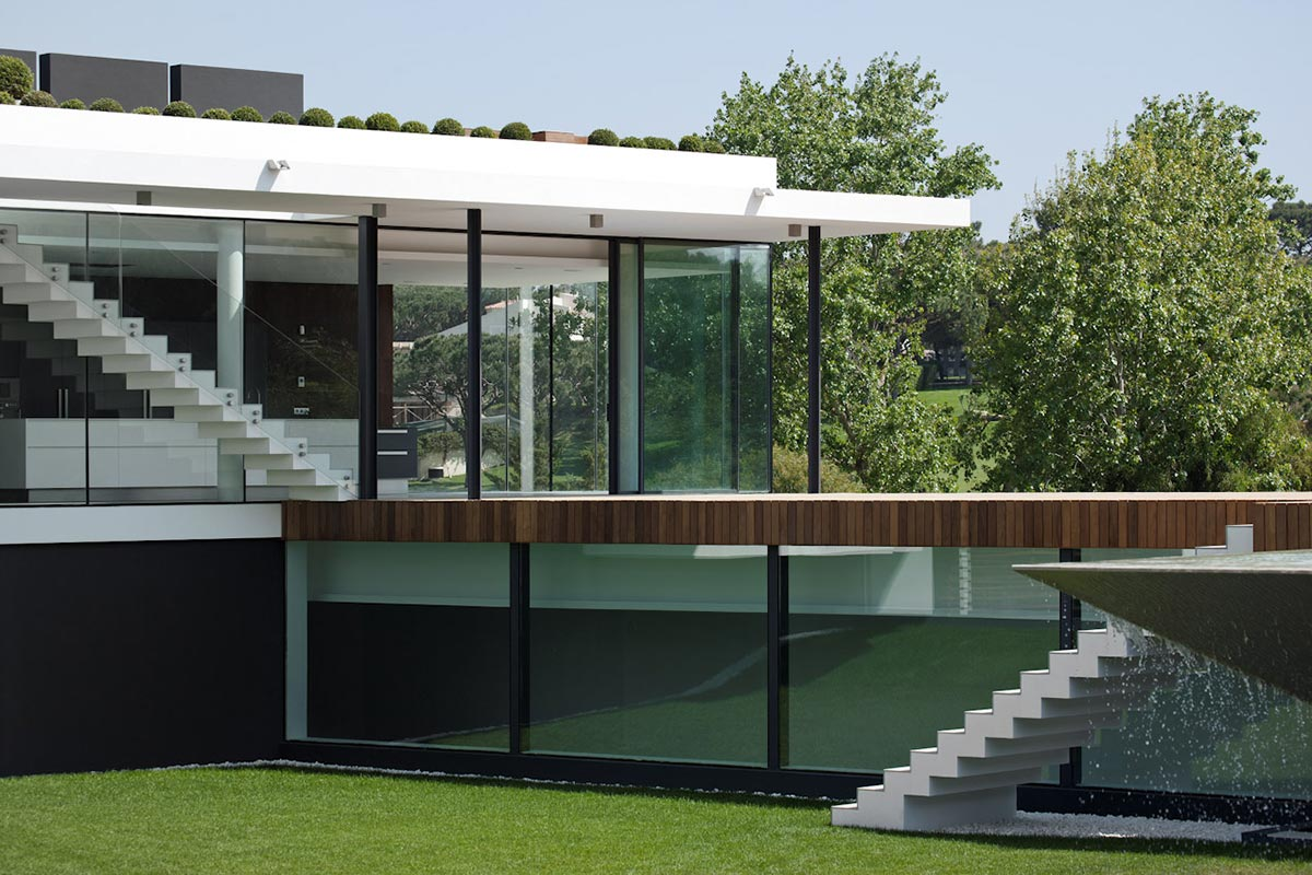 Glass Walls, Modern Home with a Unique Suspended Pool in Portugal