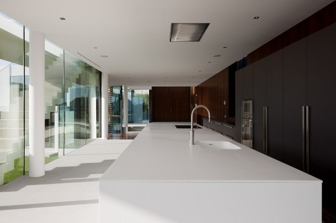 Kitchen, White Island, Modern Home with a Unique Suspended Pool in Portugal