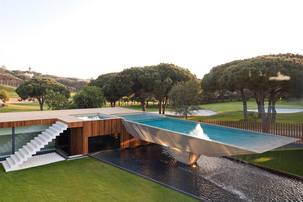 Modern home with a unique suspended pool in portugal for Modern contemporary swimming pools