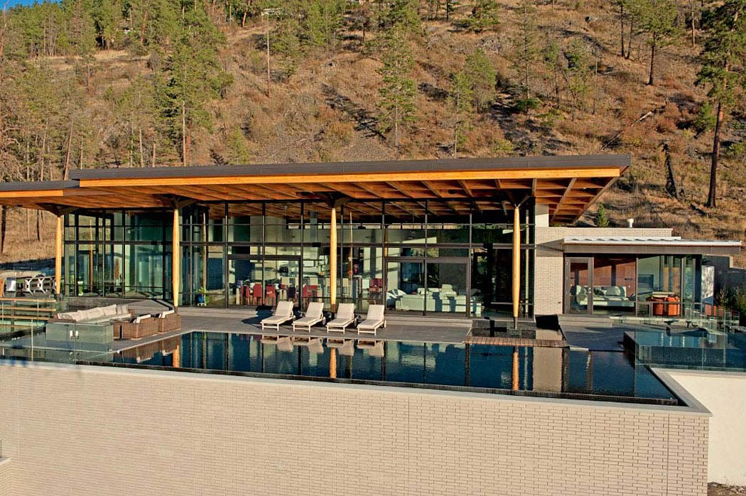 Infinity pool outdoor living exceptional hillside home for Pool design kelowna