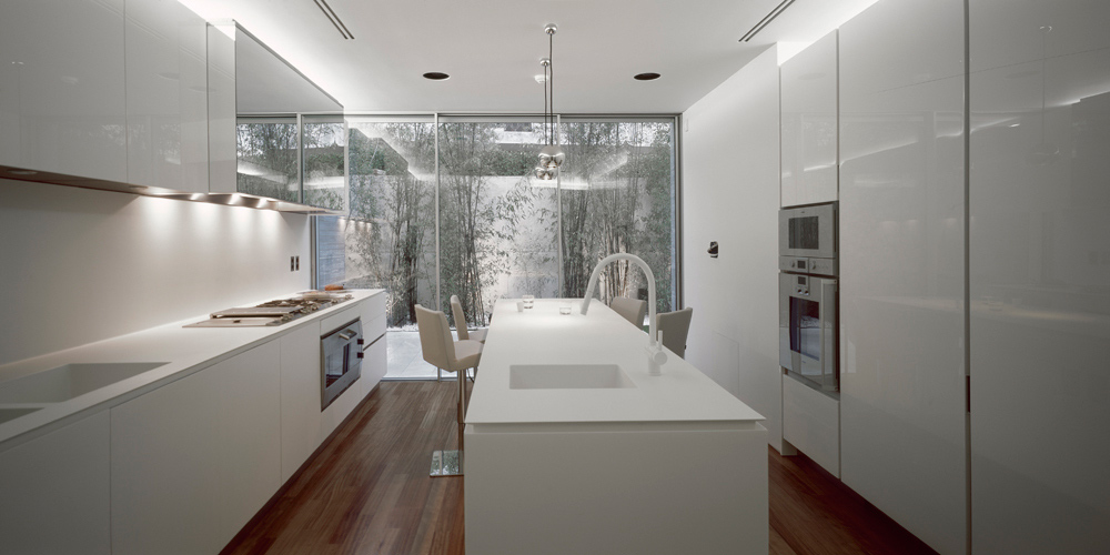 White Kitchen, Wood Flooring, Glass Walls, Psychiko House, Athens by Divercity Architects