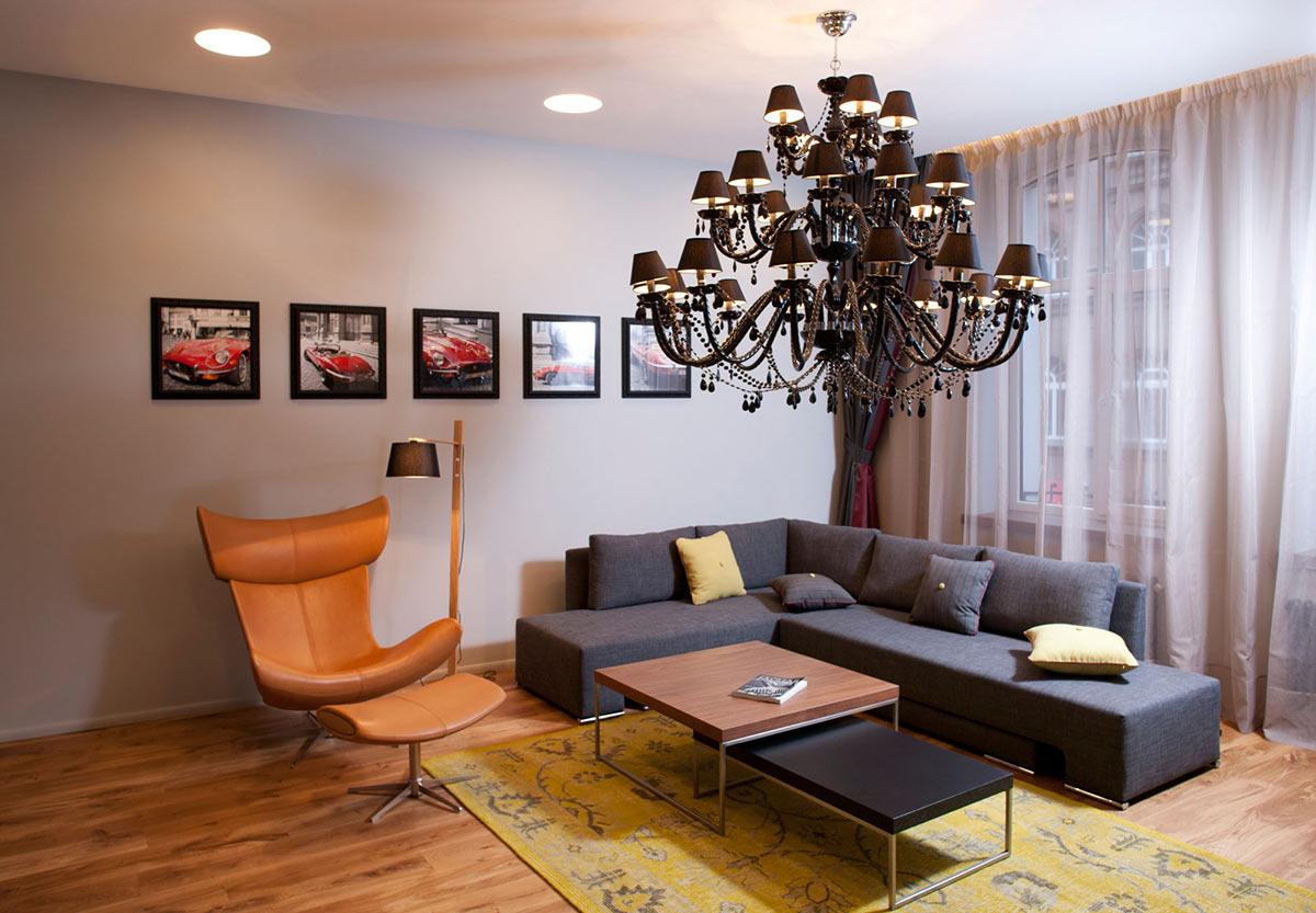 Blue Sofa, Chandelier, Studio Apartment in Riga by Eric Carlson