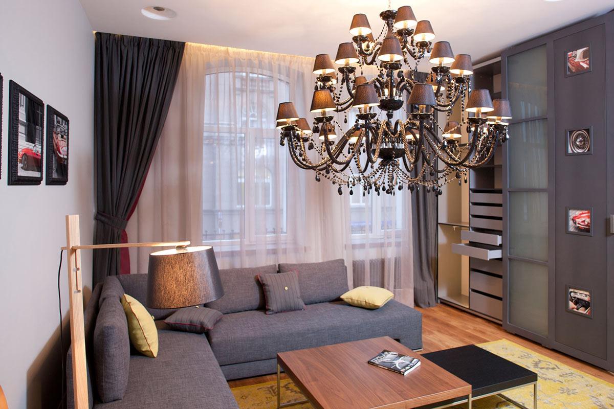 Chandelier, Blue Sofa, Studio Apartment in Riga by Eric Carlson