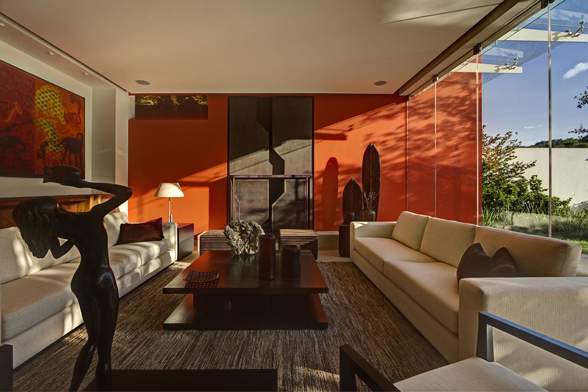 Living Room, Orange Wall, Coffee Table, Sofas, Modern Family Home in Zapopan, Mexico