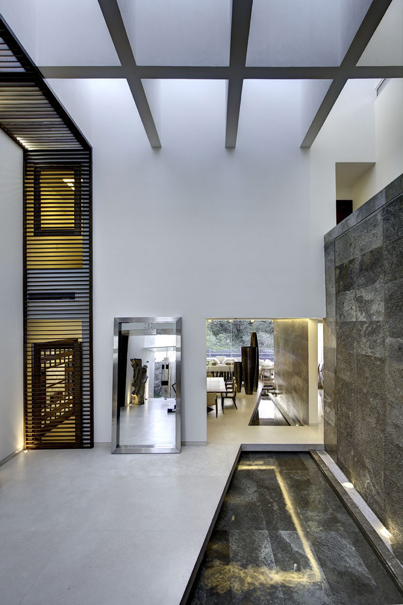 Stone Wall, Water Feature, Large Mirror, Modern Family Home in Zapopan, Mexico