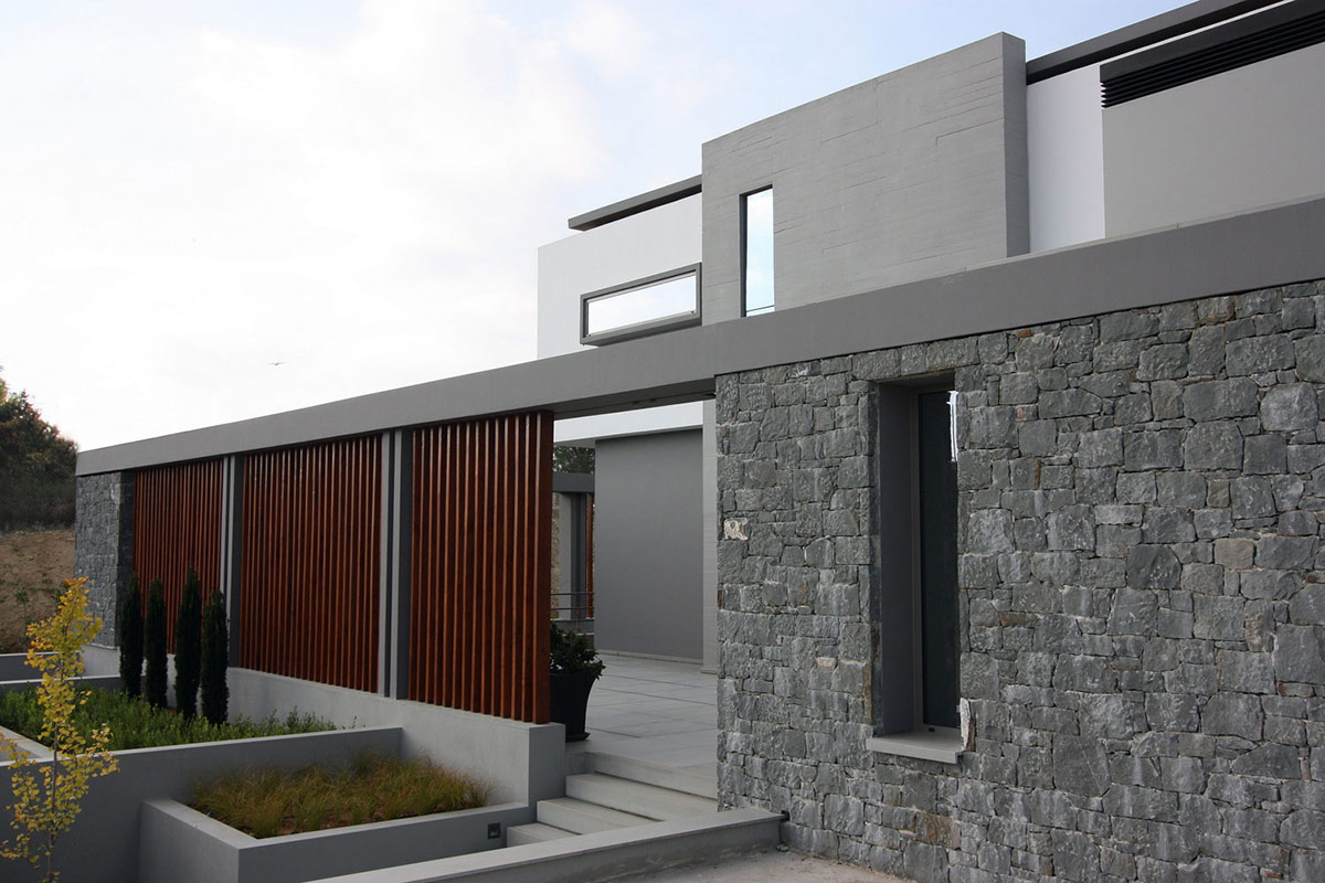 Stone Wall, Hilltop Home in Thessaloniki, Greece by Office 25 Architects