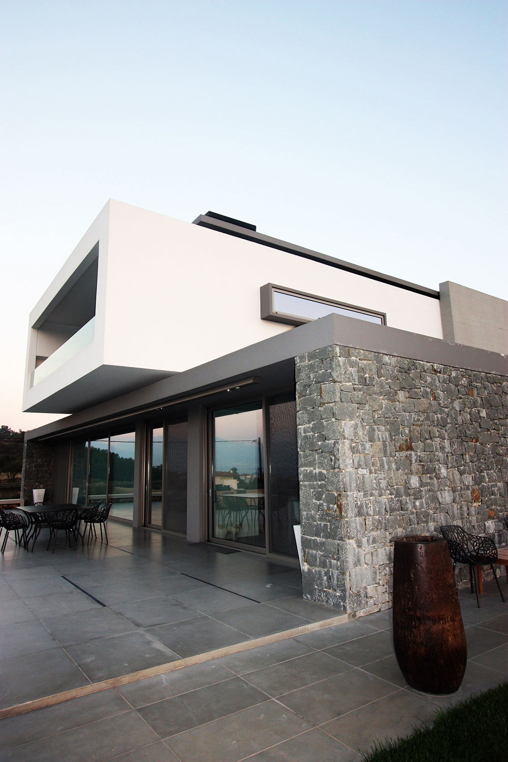 Terrace, Stone Wall, Hilltop Home in Thessaloniki, Greece by Office 25 Architects