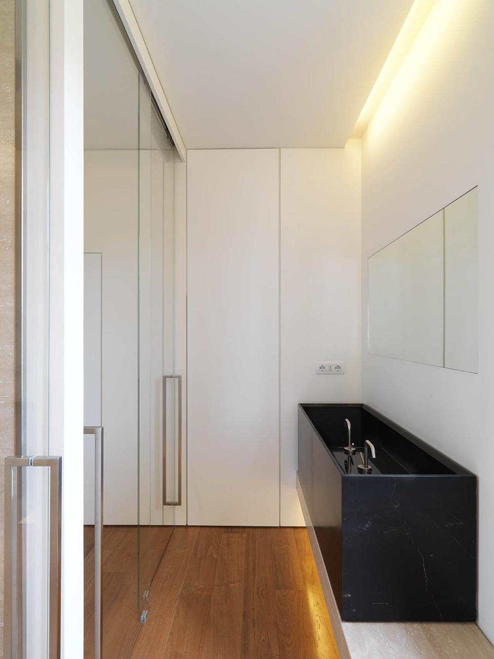 Bathroom, Dark Marble Sink, Minimalist Interior in Tuscany, Italy by Victor Vasilev