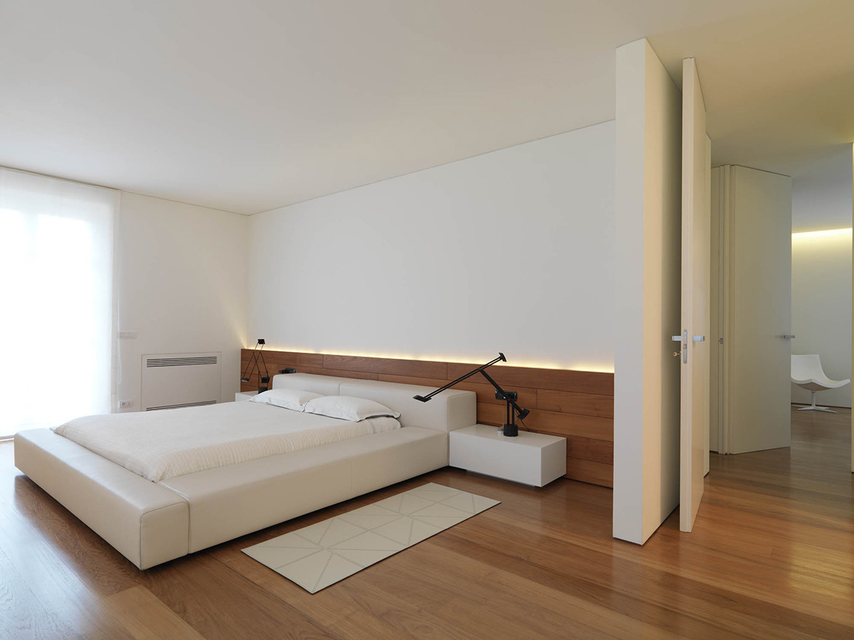 Bedroom wood flooring minimalist interior in tuscany italy by