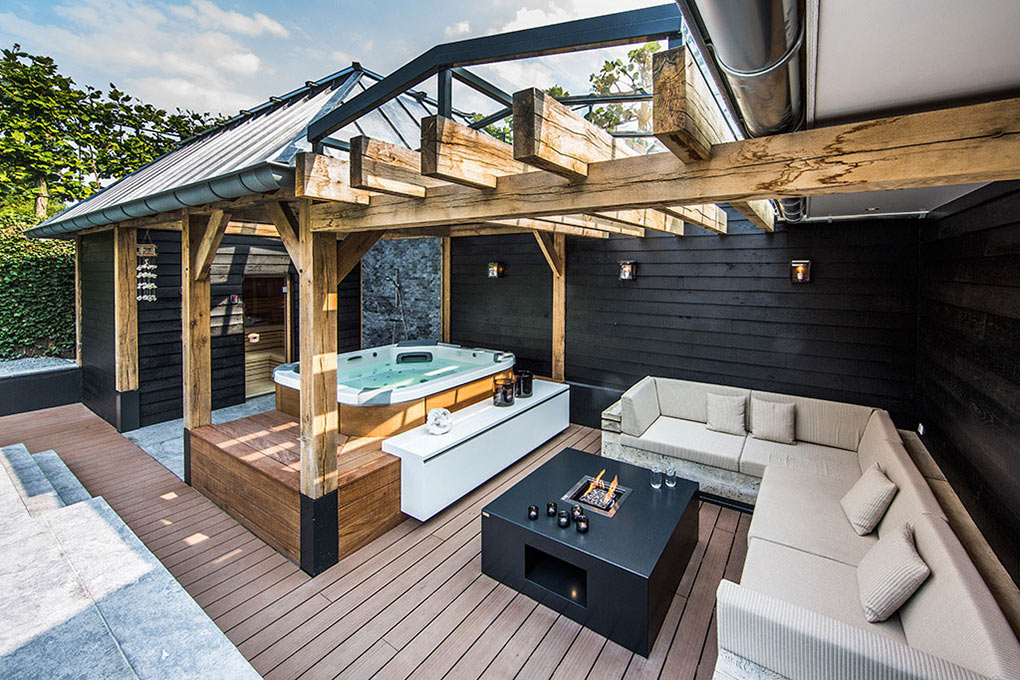 Wooden Sofa, Contemporary Fireplace, Aquatic Backyard in The Netherlands by Centric Design Group