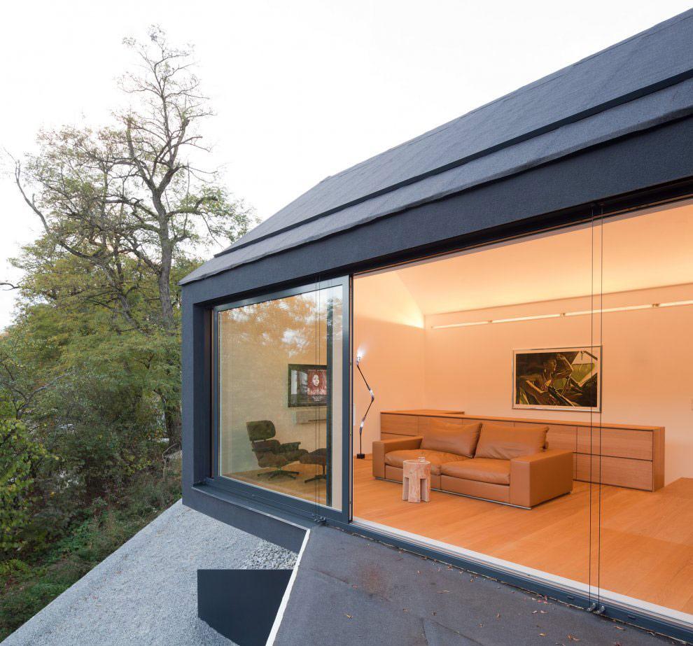 Living Space, Patio Doors, Black on White House in Wenzenbach, Germany by Fabi Architekten