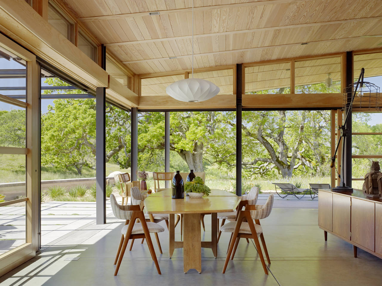Dining Space, Glass Walls, Caterpillar House in Carmel, California by Feldman Architecture