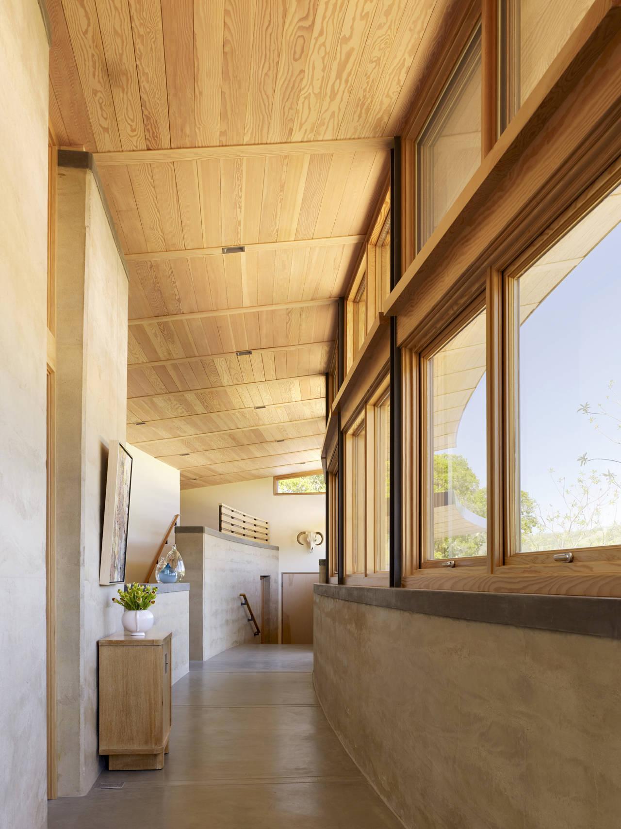 Hallway, Exposed Concrete Walls, Caterpillar House in Carmel, California by Feldman Architecture