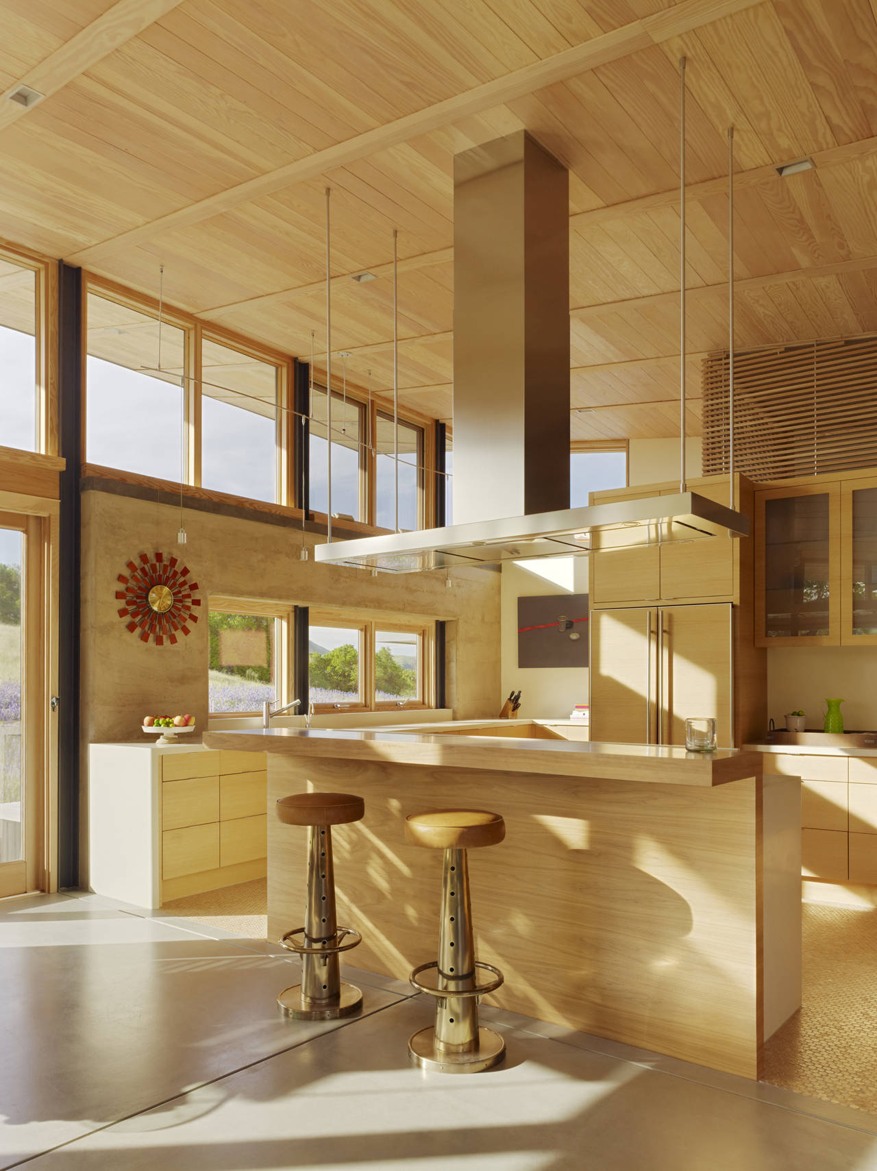 Kitchen, Breakfast Bar, Caterpillar House in Carmel, California by Feldman Architecture