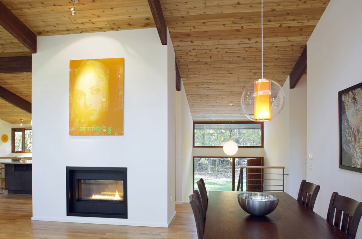 Modern Fireplace, Art, Dining Table, Deck House Renovation in Chapel Hill, North Carolina