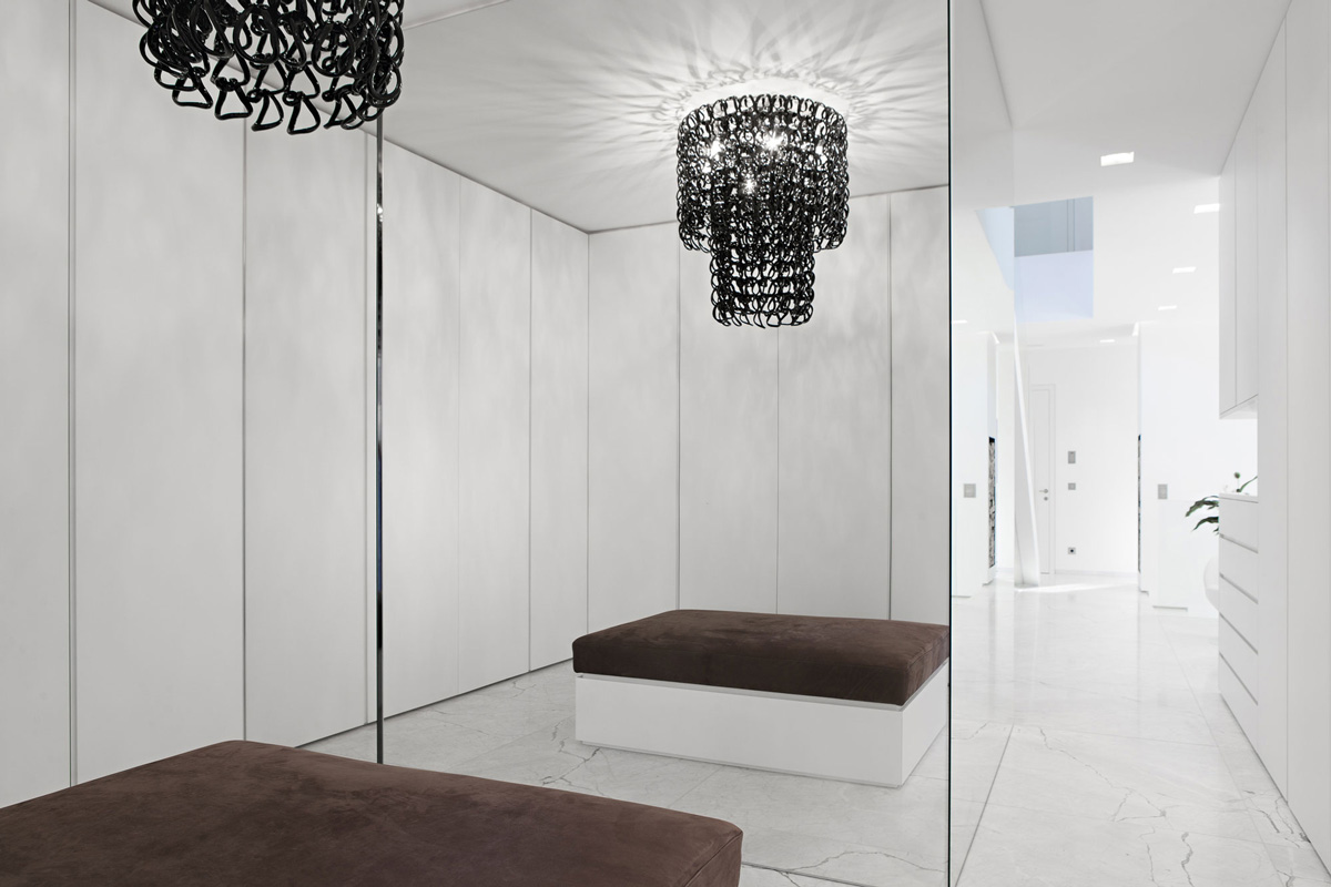 Hallway, Large Mirror, House M in Meran, Italy by monovolume architecture + design