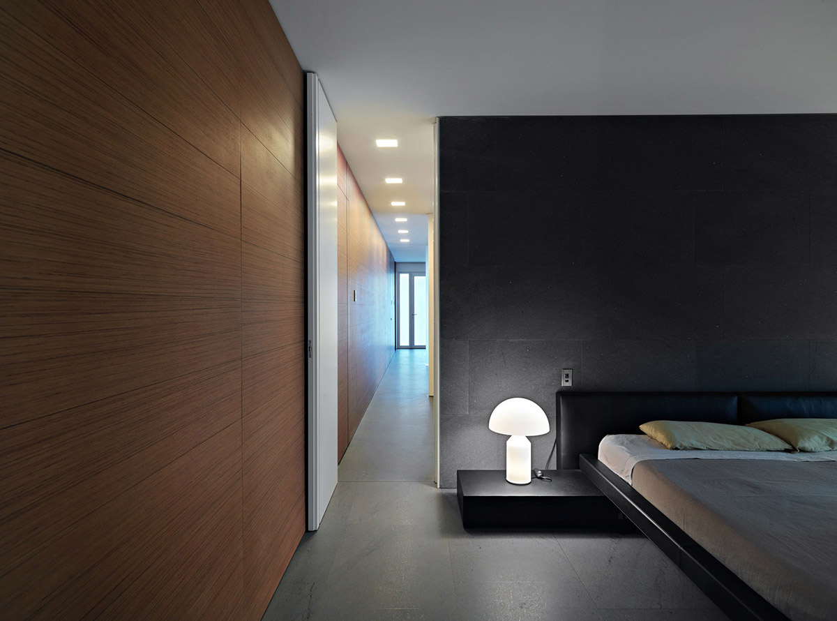 Dark Stone Wall, Bedroom, Minimalist Home in Lugano, Switzerland by Victor Vasilev