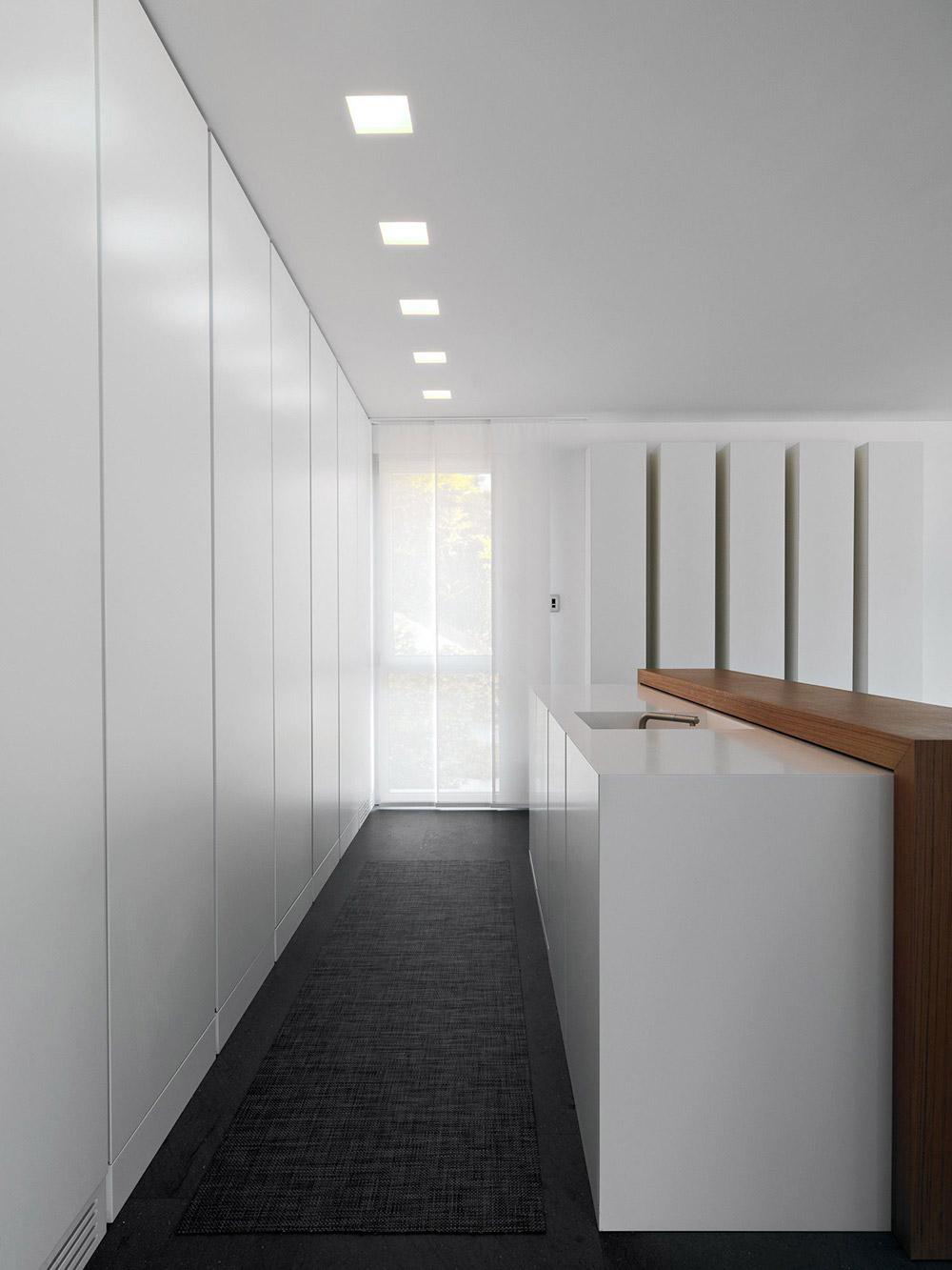 Compact Kitchen, Minimalist Home in Lugano, Switzerland by Victor Vasilev