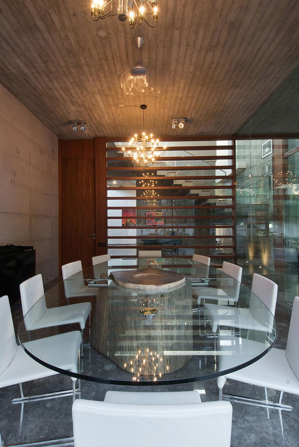 Glass Dining Table, White Chairs, Poona House in Mumbai, India by Rajiv Saini