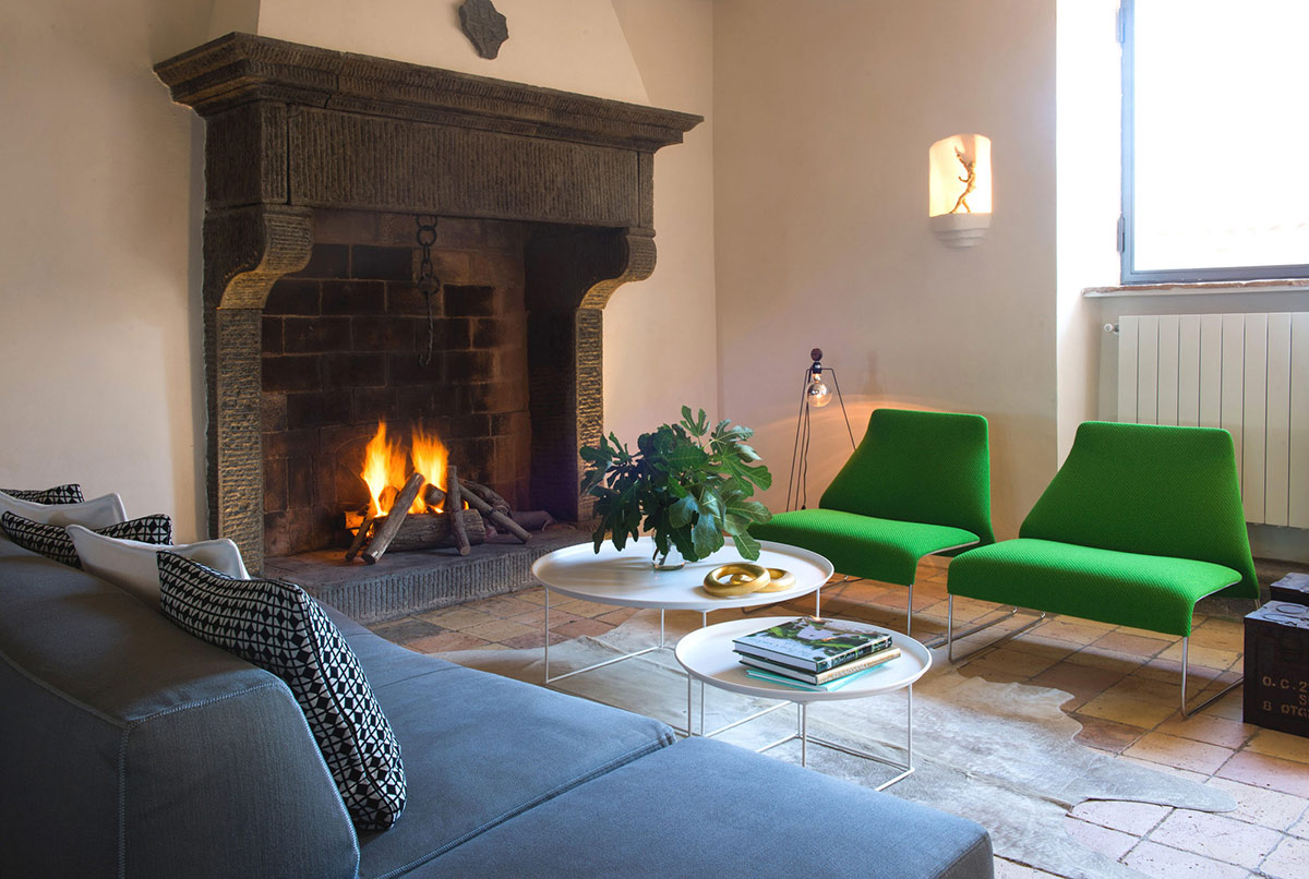 Fireplace, Living Space, Stunning Renovation in Civita di Bagnoregio by Studio F