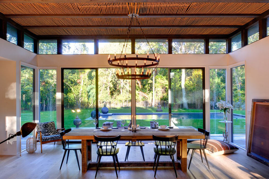Wooden Dining Table, Rustic Lighting, Robins Way Residence in Amagasett, New York by Bates Masi Architects