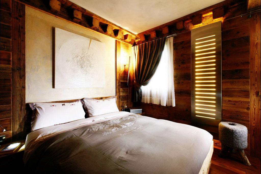 Bedroom, Ampezzo Meleres in Cortina d'Ampezzo, Italy by Gianpaolo Zandegiacomo