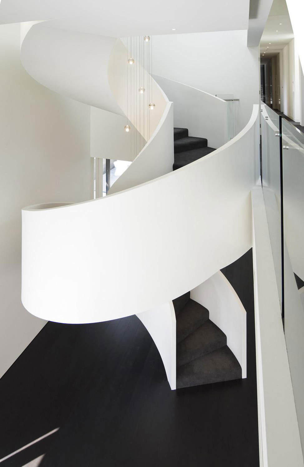 Swirling Stairs, Verdant Avenue Home in Melbourne, Australia by Robert Mills Architects