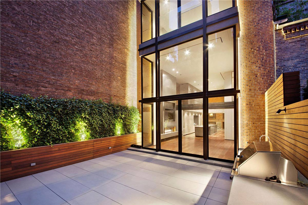 Terrace glass walls converted townhouse in greenwich Modern house architect new york