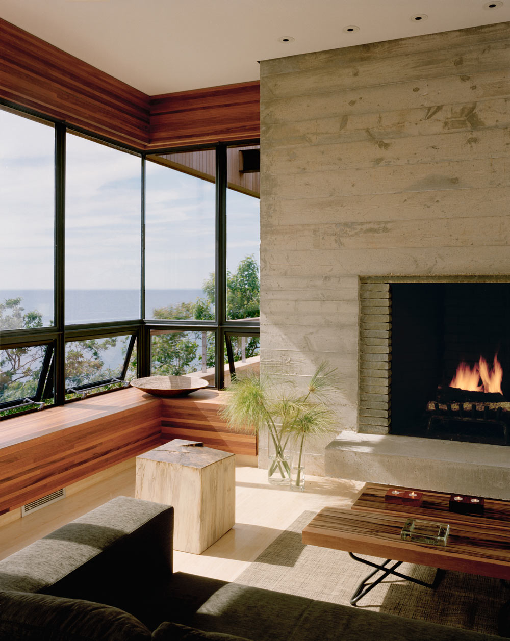 Modern Fireplace, Bluff House in Montauk, New York by Robert Young