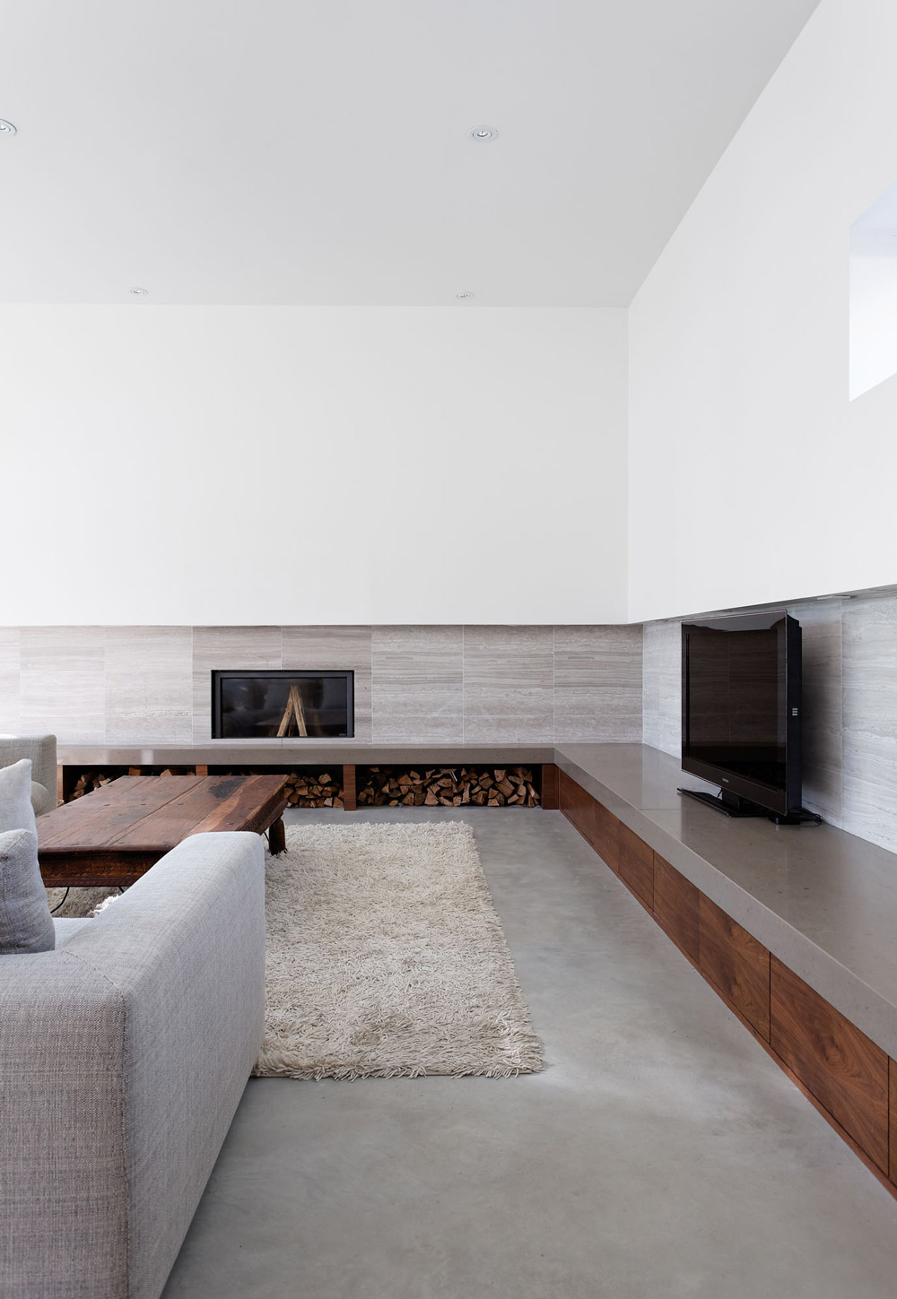 Rug, Sofa, Fireplace, Wood Store, Carling Residence in Ontario, Canada by TACT Architecture