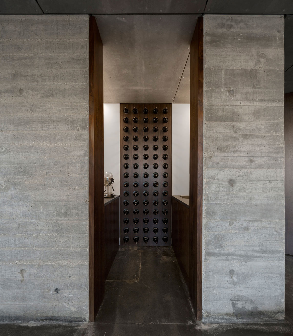 Wine Room, Concrete Floors, C+P House in Lisbon, Portugal by Gonçalo das Neves Nunes