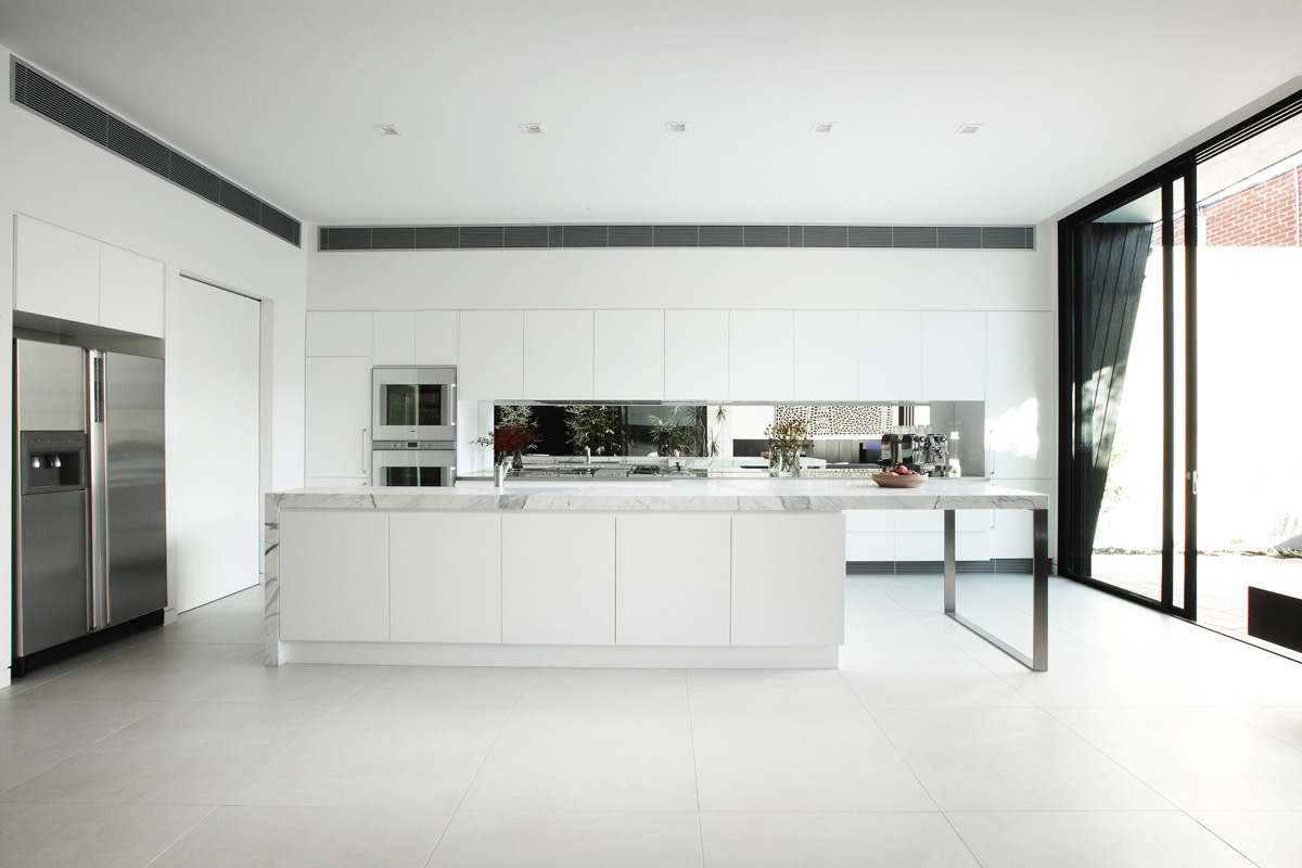 Bright White Kitchen, Marble Island, Enclave House in Melbourne, Australia by BKK Architects