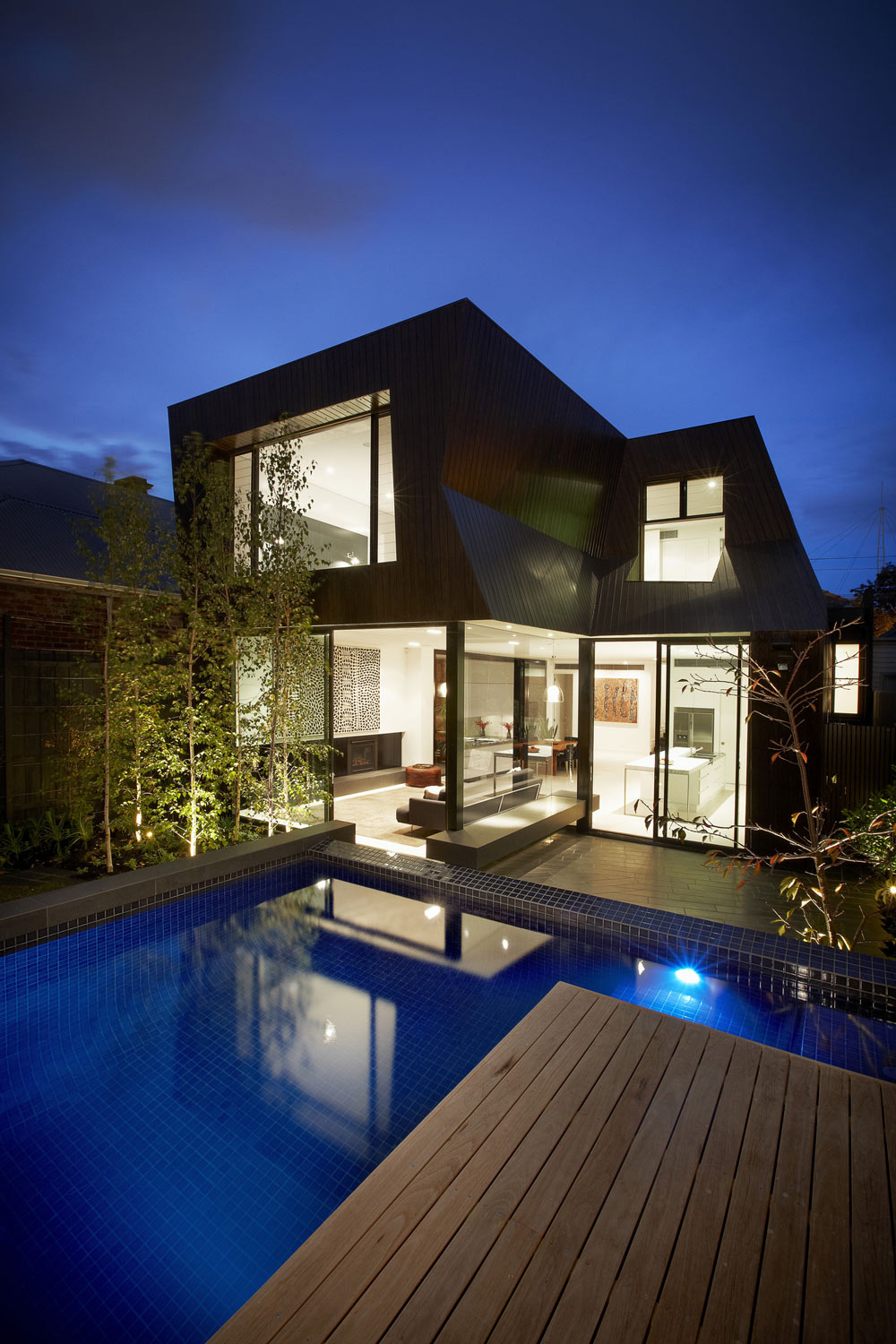 Evening Lights, Enclave House in Melbourne, Australia by BKK Architects