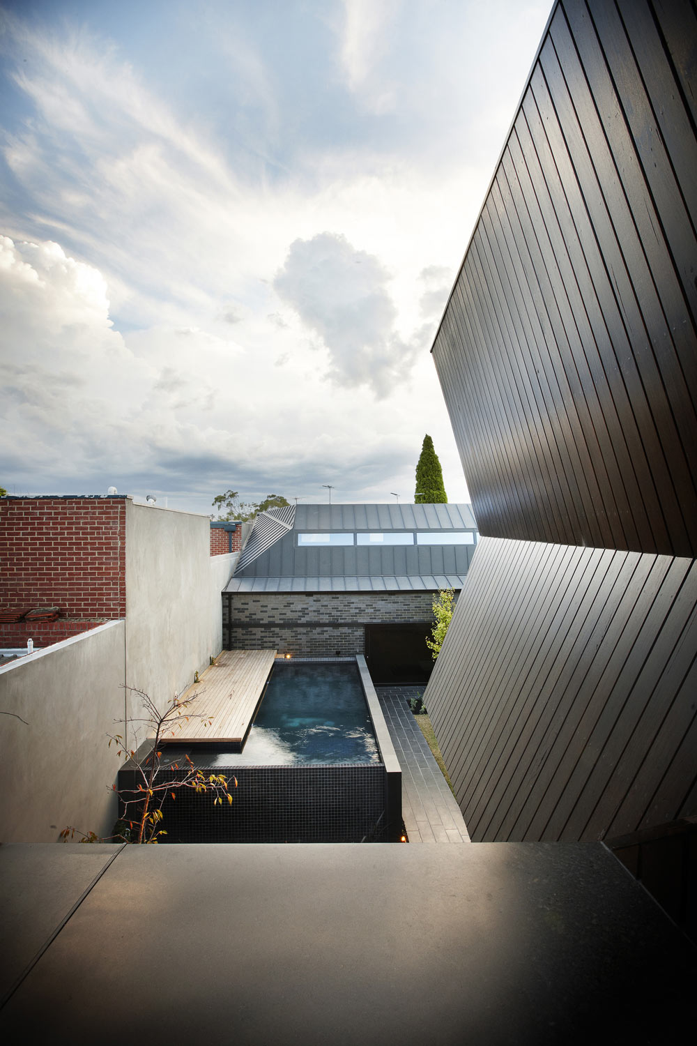 Pool, Deck, Courtyard, Enclave House in Melbourne, Australia by BKK Architects