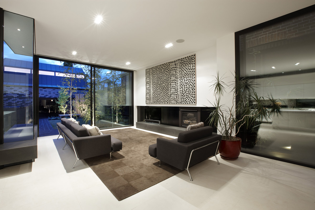 Rug, Sofas, Art, Fireplace, Enclave House in Melbourne, Australia by BKK Architects