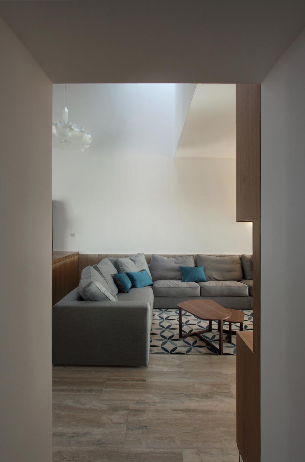 Grey Sofa, Hanging Home in Naxxar, Malta by Chris Briffa Architects
