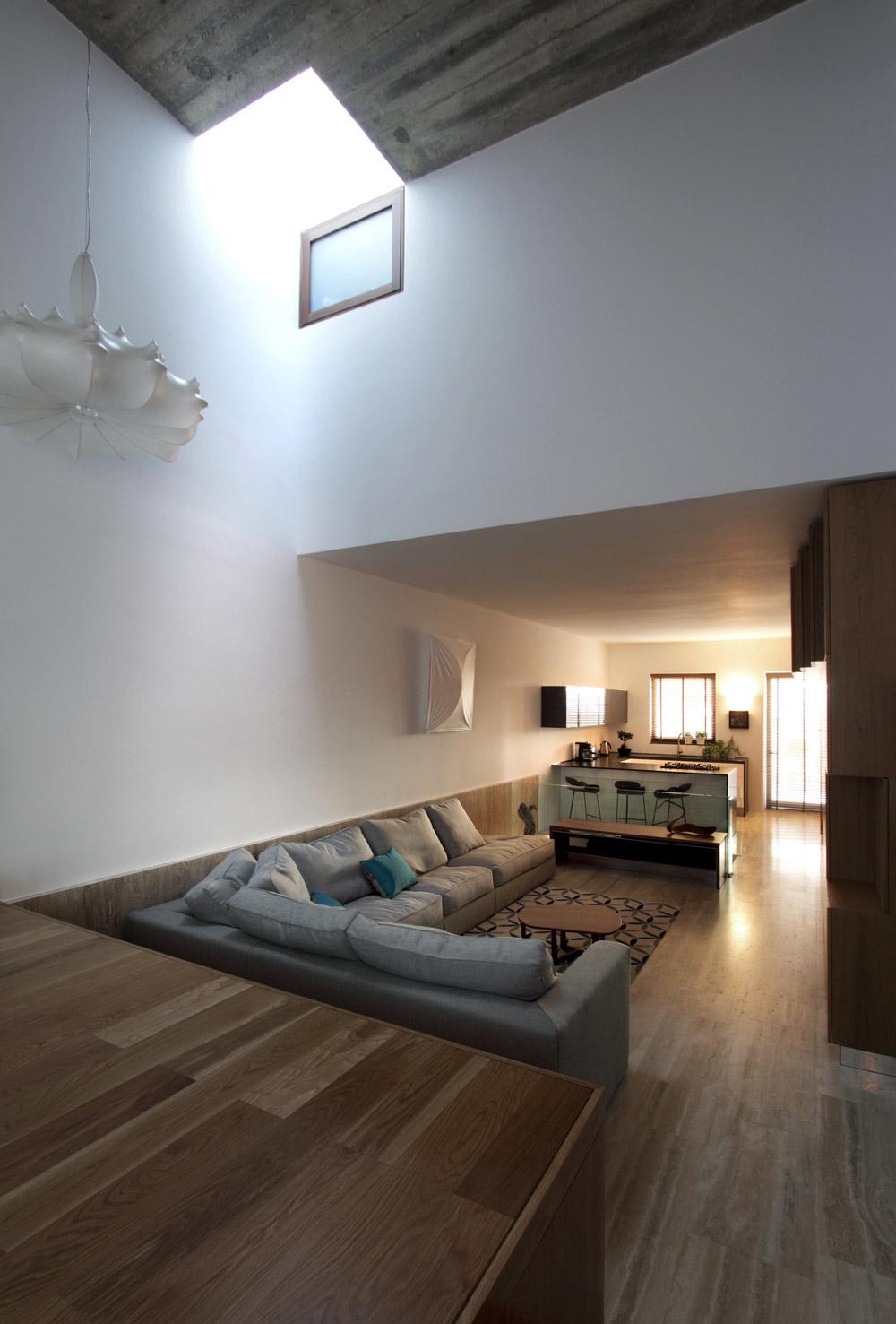 Kitchen, Breakfast Bar, Sofa, Hanging Home in Naxxar, Malta by Chris Briffa Architects